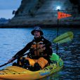 kayak fishing night fishing at night time when you need other boats and or craft to see you in the night time.
